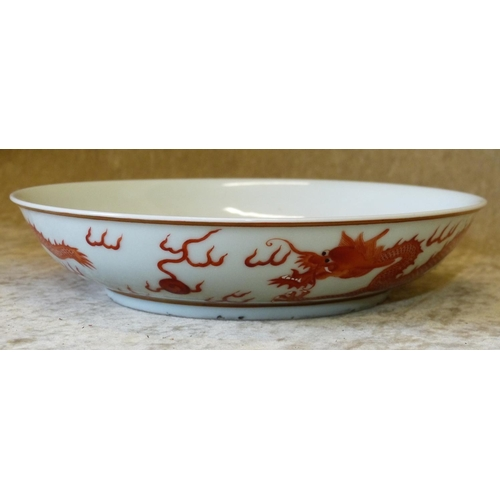 172 - An Oriental Shallow Round dish on white ground having red dragon decoration, 18cm diameter...
