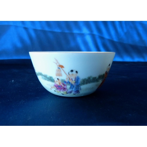 176 - An Oriental Round Tea Bowl having multicoloured children decoration, 8.5cm diameter...