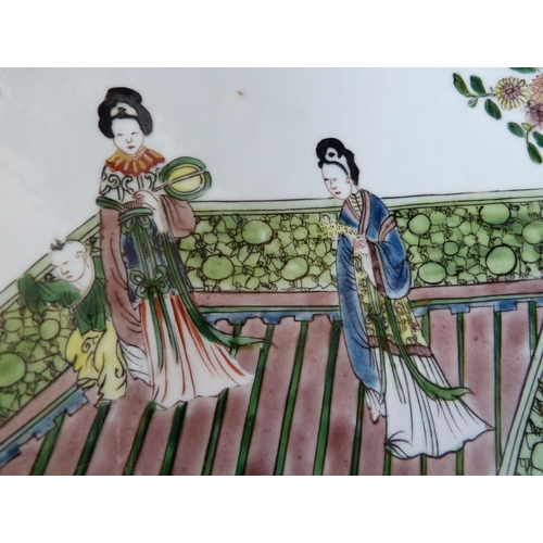 18 - An 18th Century Chinese Round Charger on white and green ground depicting 3 ladies on balcony with f...