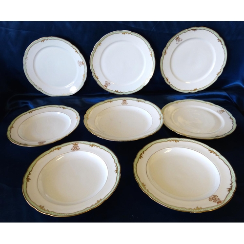 184 - 13 Limoges Dinner Plates and 2 matching larger plates having green and gilt rims depicting crests (s...