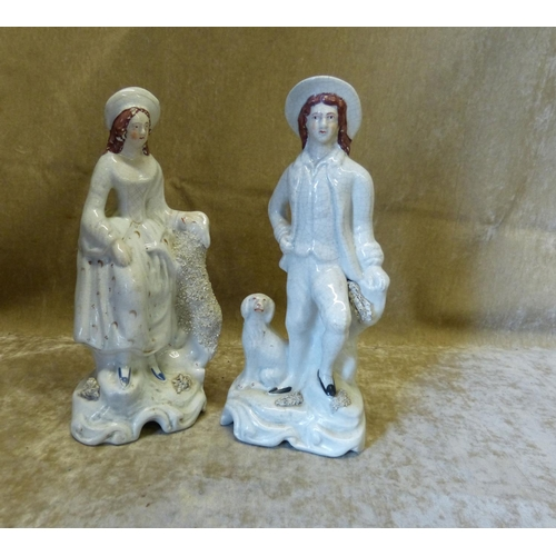 19 - A Pair of Victorian Staffordshire Figures of Gentleman and Lady standing next to dog and sheep, on w...