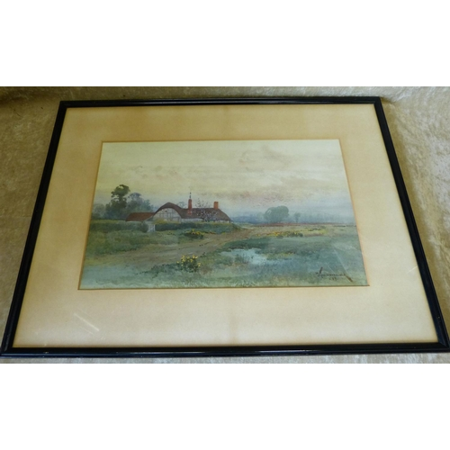 193 - J Tim MacDonald Watercolour, thatched cottage in open landscape, signed, in black frame, 26cm x 42cm...