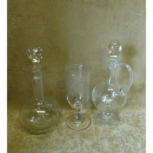 24 - A Bulbous Glass Claret Jug with stopper, having engraved grape and vine decoration, a round glass th...