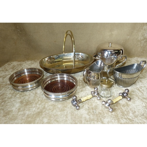 271 - A Silver Plated Round Muffin Dish with cover and liner, a pair of plated wine coasters having wooden...