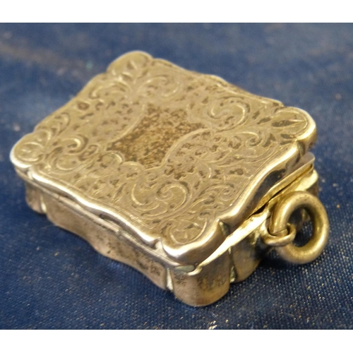 288 - A Victorian Silver Rectangular Scalloped Vinaigrette having chased decoration, hinged lid enclosing ...