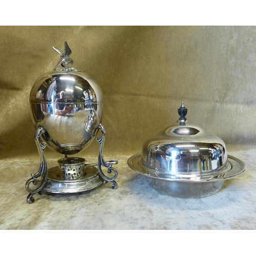291 - A Silver Plated Egg Warmer with cover and burner on splayed scroll feet, also a silver plated muffin...