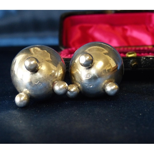 297 - A Pair of London Silver Bullet Shape Pepper Pot on ball feet in fitted black leather case...