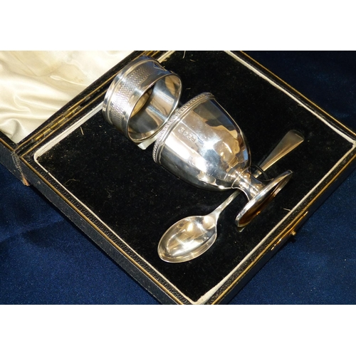 299 - A Sheffield Silver Egg Cup and Matching Spoon in fitted black leather case with similar silver napki...