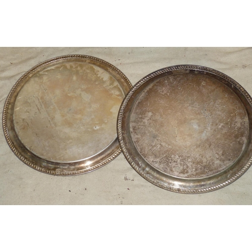 302 - A Pair of Silver Plated Round Trays having gadroon rims with engraved centres, 48cm diameter...