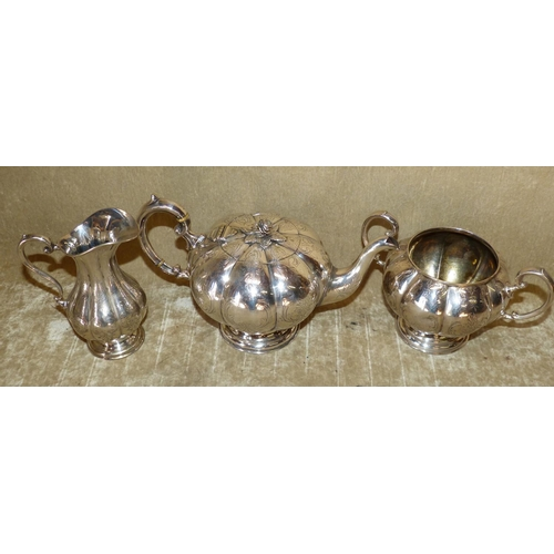 306 - A 3-Piece Silver Plated Bulbous Melon Shaped Tea Service having engraved decoration comprising teapo...