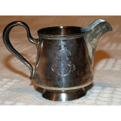 314 - A Russian Silver Coloured Metal Milk Jug, stamped AK having chased floral and monogram decoration, 2...