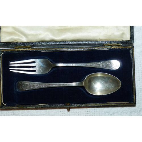 321 - 2 Similar Sheffield Silver Child's Fork and Spoon having chased floral and leaf decoration, makers m...