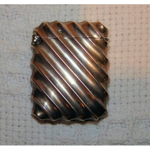 327 - A Chester Silver Vesta Case having all over fluted decoration with hinged lid...