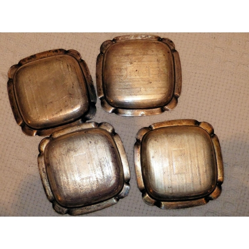 328 - A Set of 4 Sterling Silver Small Square Ashtrays having engine turned decoration, 2.5oz...
