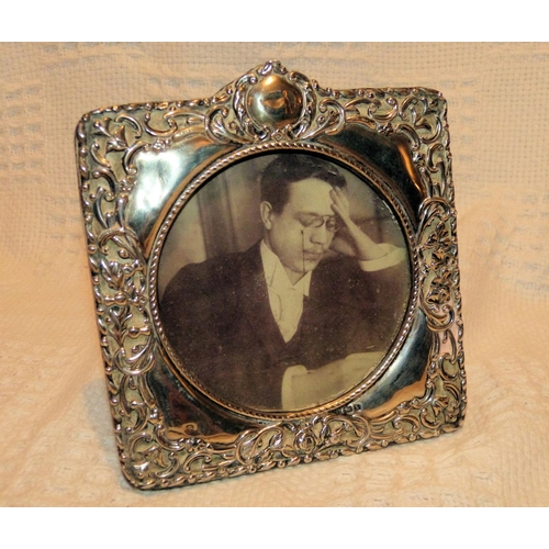 330 - An Edward VII Square Freestanding Silver Mounted Photograph Frame having raised scroll and leaf deco...