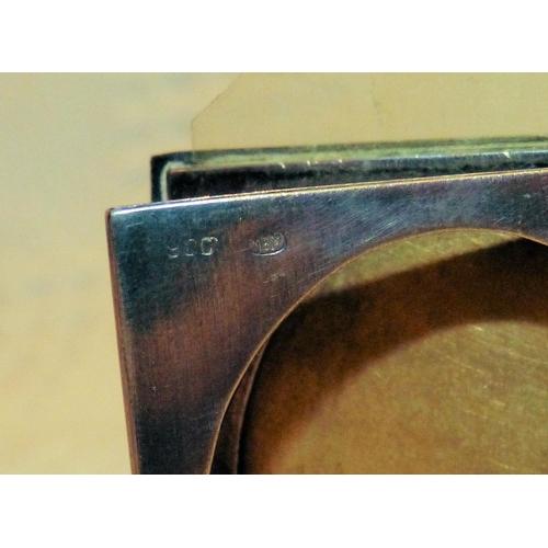 334 - A 900 Silver Coloured Metal Small Book Shape Folding Photograph Frame having engine turned decoratio...