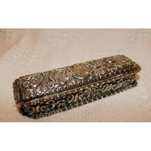 340 - An Edward VII Silver Rectangular Box having all over embossed floral and scroll decoration, crinkled...
