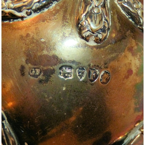 344 - A Victorian Silver Sugar Bowl having rams head, swag and reeded decoration, splayed feet, London 188...