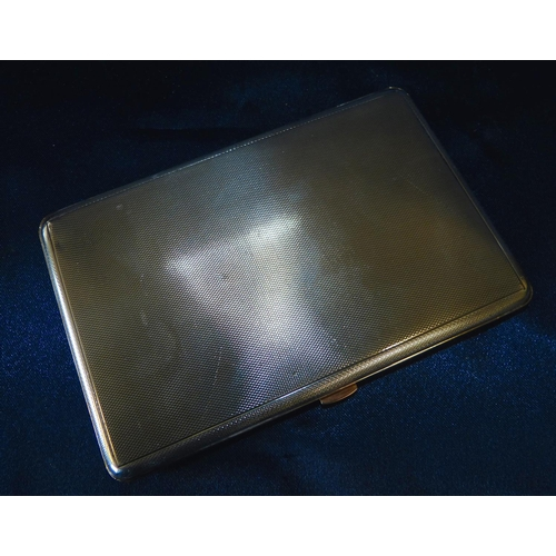 349 - A George V Silver Cigarette Case having engine turned decoration, hinged front enclosing gold covere...