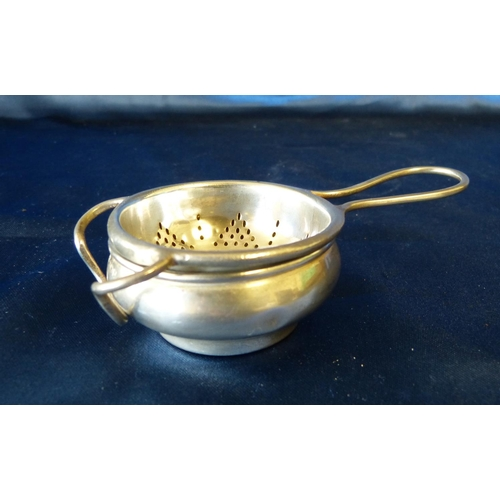 359 - A Birmingham Silver Tea Strainer with matching bulbous shape stand, 1.8oz...