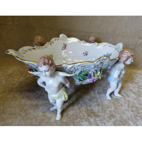 36 - A Modern Dresden Oval Scalloped Fruit Bowl with 4 supports in form of ringed cupids having all over ...
