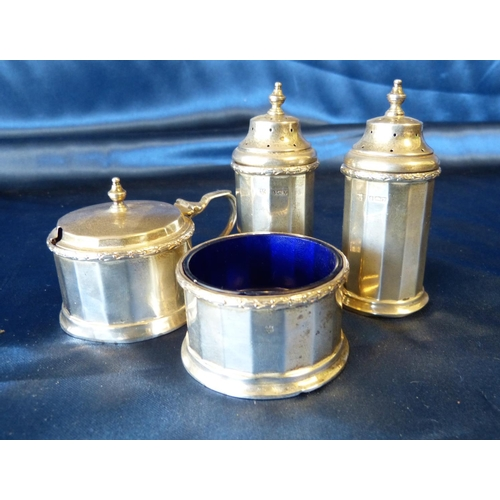 361 - A 4-Piece Birmingham Silver Condiment Set having chamfer decoration comprising pair of pepper pots, ...