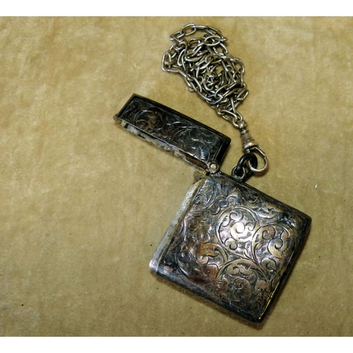 368 - A Chester Silver Vesta Case having hinged lid with embossed floral and scroll decoration mounted wit...