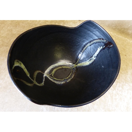 37 - A Modern Studio Pottery Bulbous Fruit Bowl on black ground with inner bird motif, 28.5cm wide...