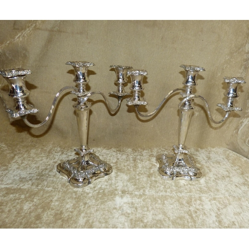 370 - A Pair of Silver Plated 3 Light-2 Branch Candelabra having scroll arms with embossed floral and scro...