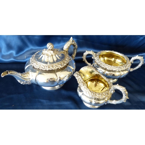 371 - A Scottish George IV Silver Bulbous 3-Piece Tea Service having raised floral and leaf decoration com...