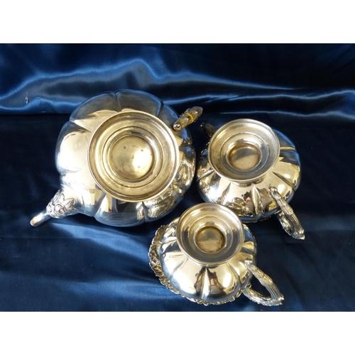371 - A Scottish George IV Silver Bulbous 3-Piece Tea Service having raised floral and leaf decoration com...