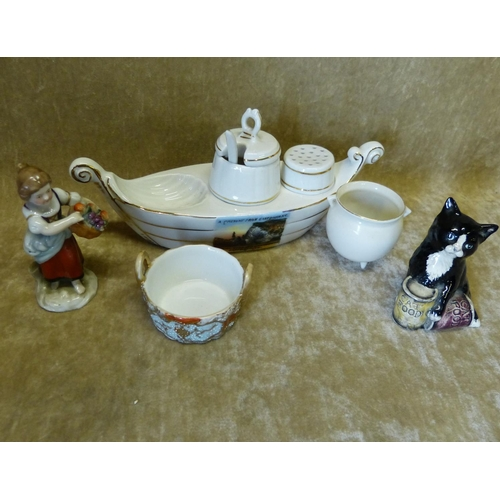 38 - A Royal Doulton Figure of a Seated Cat, a small continental china figure of a lady holding basket of...