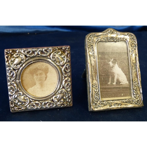 387 - A Birmingham Square Silver Freestanding Photograph Frame having embossed decoration, 7.5cm wide, als...
