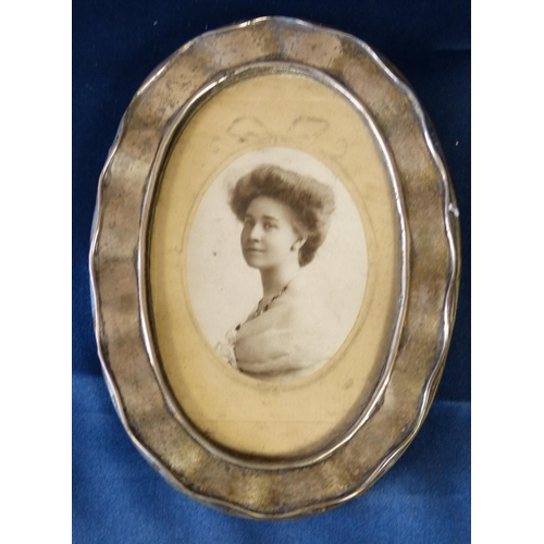 388 - An Oval Birmingham Silver Mounted Freestanding Photograph Frame having scalloped rim (stand to back ...