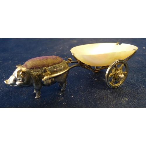 391 - An Edward VII Miniature Silver Pin Cushion in form of a pig pulling a cart having mother of pearl bo...
