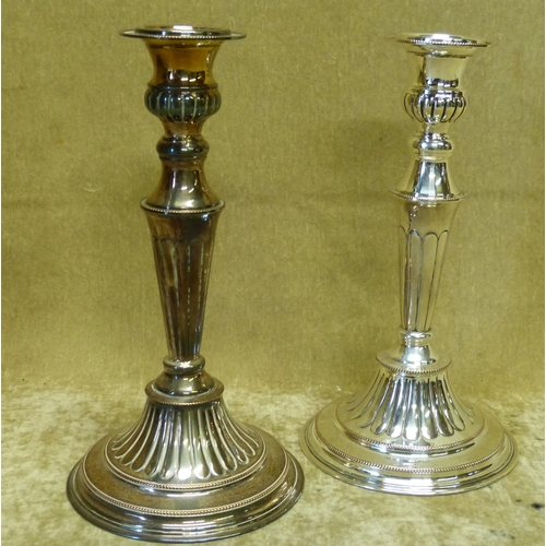 394 - A Pair of Elkington Silver Plated Candlesticks on turned stems having sweeping bases with raised bal...