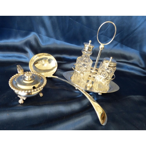 395 - A Silver Plated Oval Boat Shape Stand having centre carrying handle mounted with 2 cut glass bottles...