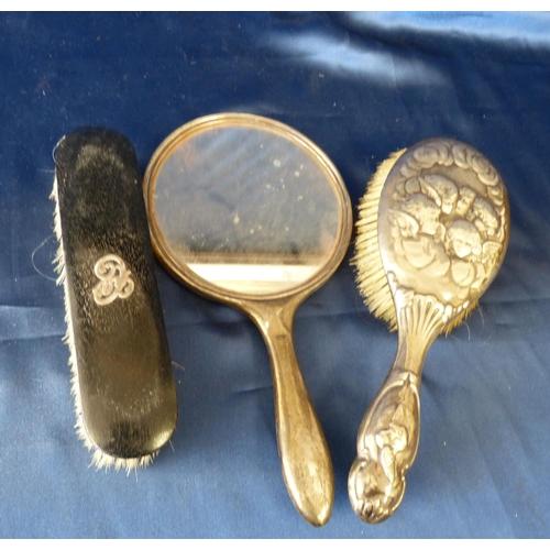 397 - A London Silver Hair Brush having embossed Cupid motifs, a Birmingham silver plain hand mirror and a...