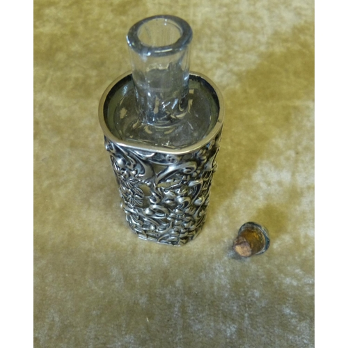403 - A Victorian Glass Scent Bottle in Birmingham Silver Frame having pierced and embossed floral and scr...
