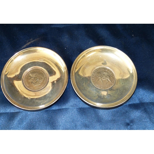 410 - 2 Modern London Silver Round Dishes both inset with coins, overall weight 5oz gross...