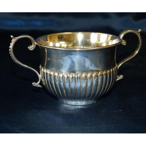 415 - A Victorian Silver 2-Handled Porringer having half embossed reeded decoration and scroll arms, Londo...