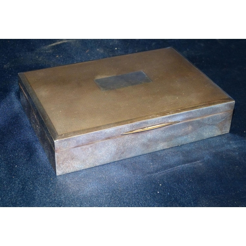 418 - A Birmingham Silver Rectangular Cigarette Box having engine turned hinged lid enclosing cedar lining...