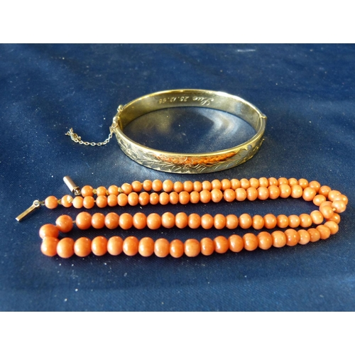 428 - A Coral Bead Necklace also a gold plated hinged bangle...