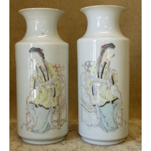43 - A Pair of Oriental Round Cylindrical Trumpet Shape Vases on white ground with multicoloured figures ...