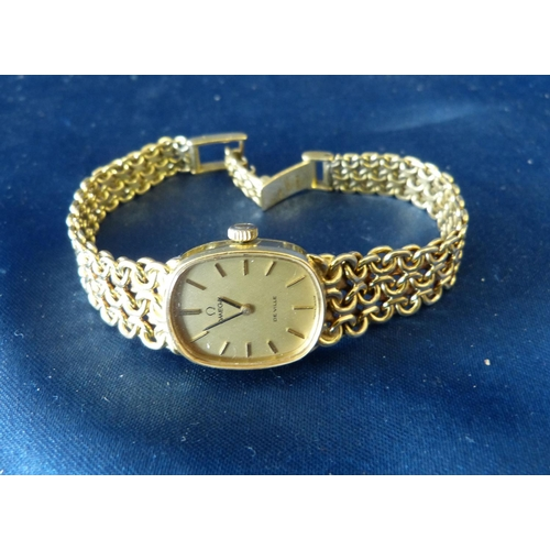 443 - An Omega De Ville Ladies 18ct Gold Wrist Watch having matching strap bracelet, weighable gold 31.9gm...