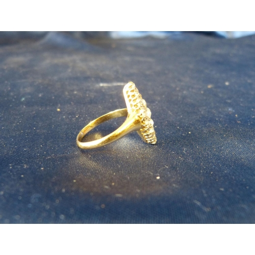 444 - A Ladies Gold Boat Shape Ring set with centre diamond surrounded by 18 further graduated diamonds...