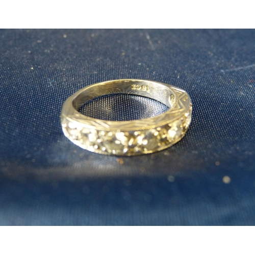 445 - An 18ct White Gold Ladies Half Eternity Ring set with 7 graduated diamonds (centre diamond approxima...