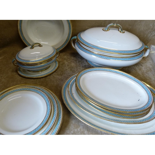 45 - A Mintons Dinner Service on white ground having turquoise and gilt rim comprising 2-handled lidded s...