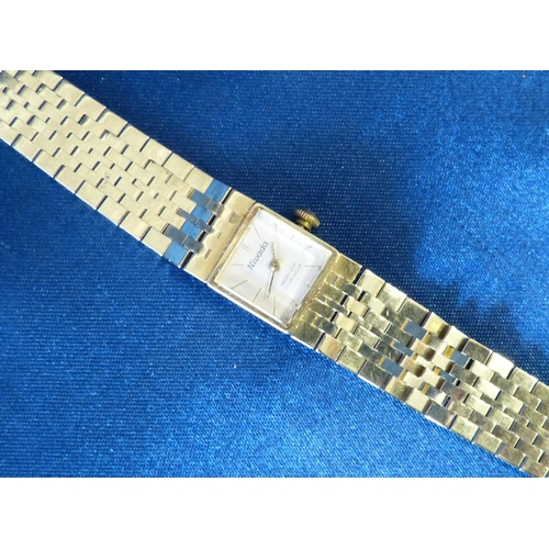 450 - A 14ct Gold Nivada 17 Jewel Wrist Watch with matching strap bracelet, weighable gold 29.6gms gross...