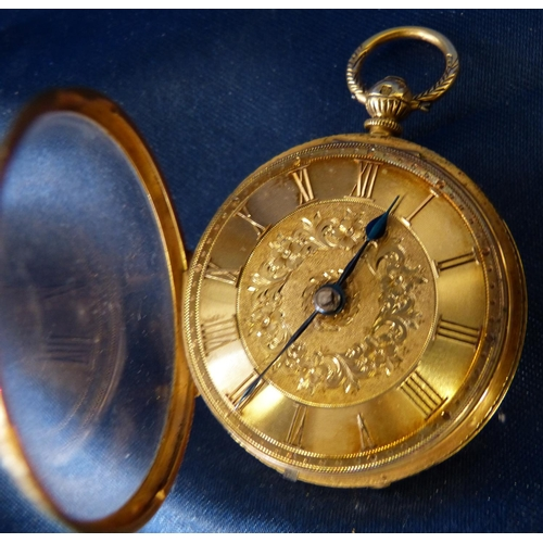 454 - An 18ct Gold Open Face Fob Watch with raised Roman numerals and engraved decoration, overall weight ...